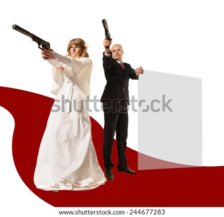 Pretty couple with the guns is aiming on somebody - stock photo