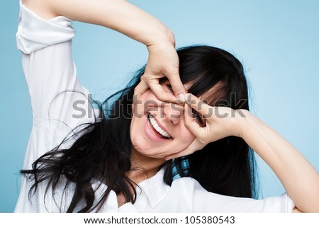 pretty crazy teenage girl pulling funny faces - stock photo