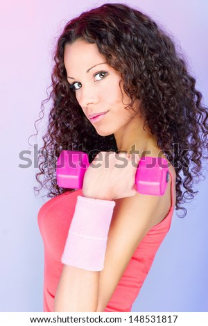 Pretty curls hair girl holding weight for exercise - stock photo