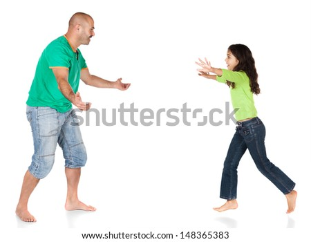 Pretty cute caucasian girl wearing a green long sleeve top and blue jeans is running to her father. - stock photo