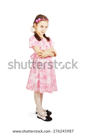 Pretty cute young girl wearing the pink dress - stock photo