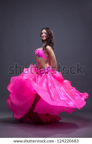 Pretty dancer performing oriental dance - stock photo