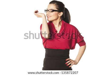 pretty dark-haired girl with glasses enjoys the scent of her perfume in hand - stock photo