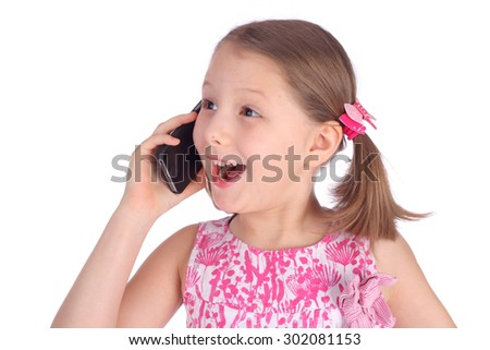pretty emotional little girl speaking by mobile phone - stock photo
