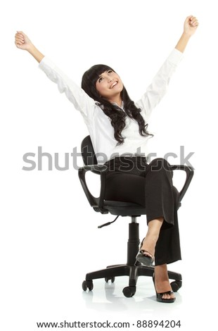 Pretty excited young woman sitting on chair celebrating victory - Isolated on white background - stock photo