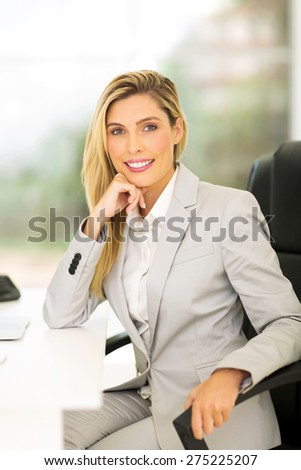 pretty female business executive in modern office - stock photo
