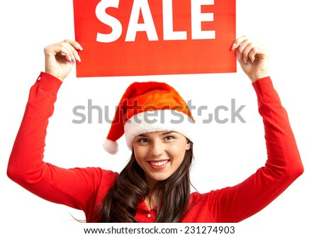 Pretty female in Santa cap inviting you for xmas sale - stock photo