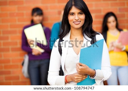 pretty female indian university student and friends - stock photo