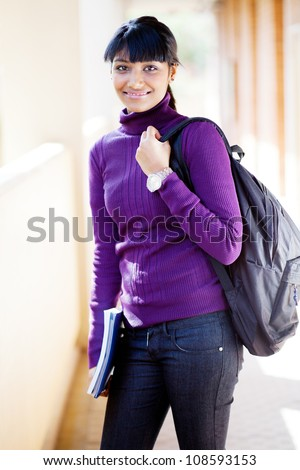 pretty female indian university student on campus - stock photo