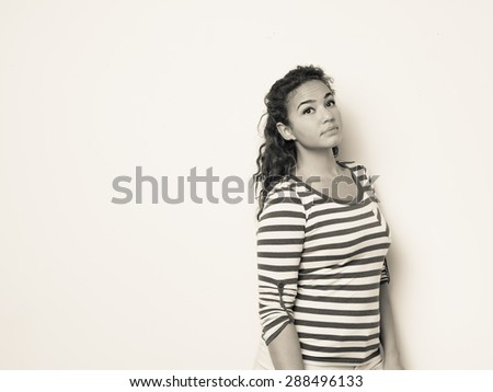 Pretty female with long curly wavy hair - stock photo