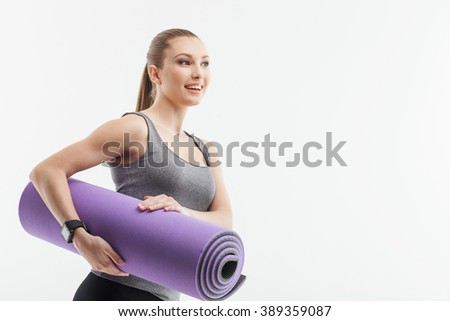 Pretty fit woman is ready for exercising - stock photo