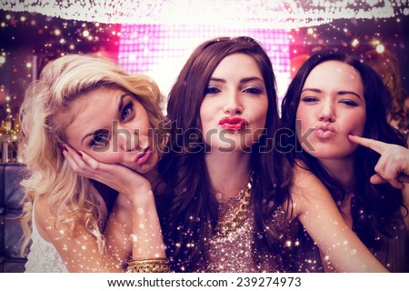 Pretty friends against gold and red lights - stock photo
