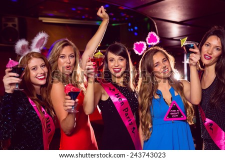 Pretty friends on a hen night at the nightclub - stock photo