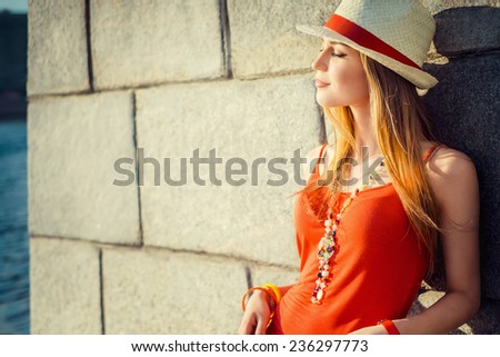Pretty girl at the wall - stock photo