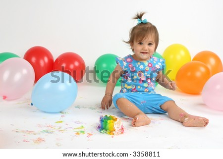 pretty girl celebrates her first birthday - stock photo
