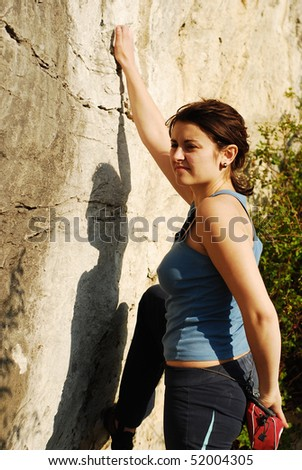 pretty girl climbing - stock photo