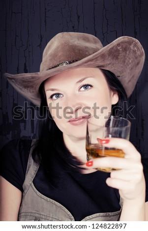 pretty girl cowboy drink whiskey - stock photo