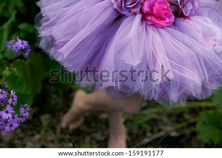 Pretty girl dressed in a tutu. - stock photo