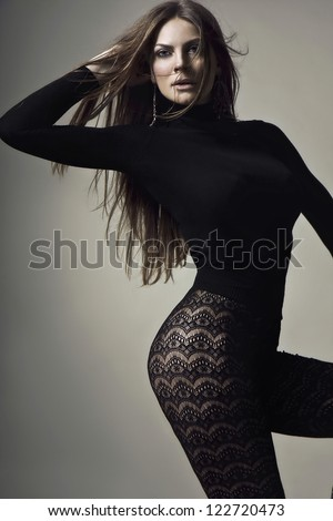 pretty girl dressed in tight clothing - stock photo