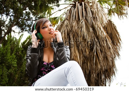 pretty girl engrossed with the music - stock photo