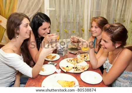 pretty girl-friends in drawing room - stock photo