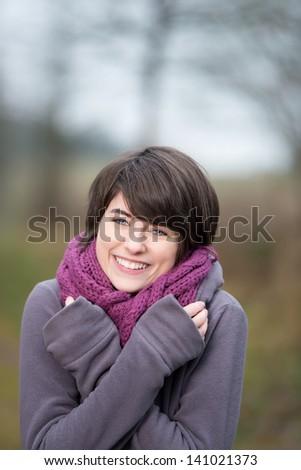 Pretty girl having fun in the winter time - stock photo