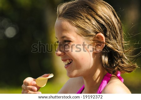 pretty girl having fun outdoors - stock photo