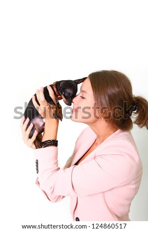 Pretty girl holding a black Chihuahua - stock photo