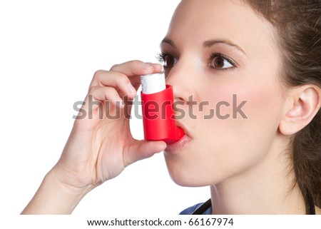 Pretty girl holding asthma inhaler - stock photo