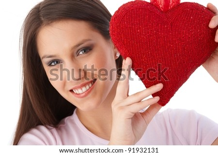 Pretty girl holding red heart at valentine's day smiling.? - stock photo