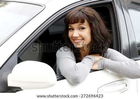 Pretty girl in a car