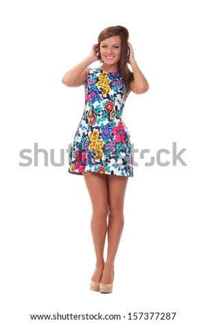 pretty girl in a dress on a white background - stock photo