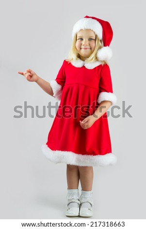 Pretty girl in a red Christmas costume - stock photo