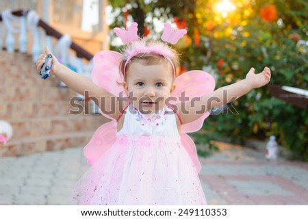 pretty girl in butterfly pink dress  - stock photo