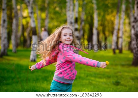 Pretty girl in park.   girl running in the park. Wind blows hair. Happiness, smile, summer - stock photo