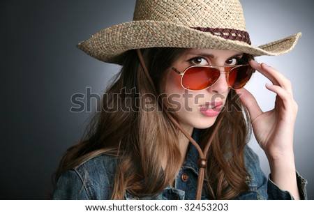 pretty girl in the cowboy hat and sunglasses - stock photo