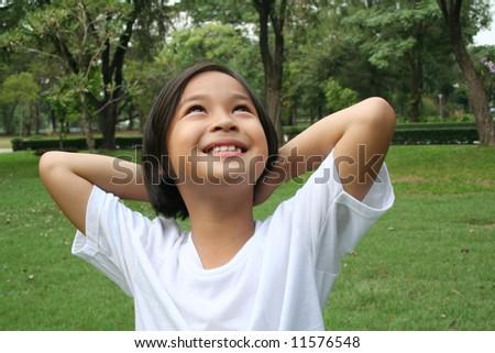 Pretty girl in the park. - stock photo