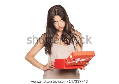 pretty girl is not satisfied with her gifts - stock photo