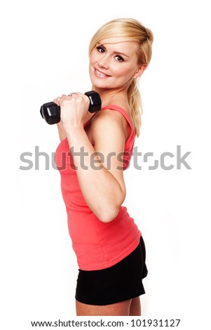 Pretty girl keeping her beautiful shape exercising with hand weights and a smile - stock photo