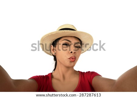 Pretty girl make a duck face, and take a selfie portrait - stock photo