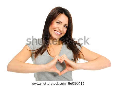 Pretty girl making a heart symbol with her hands over her heart - stock photo