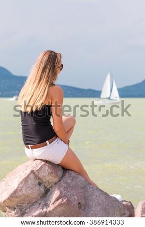 Pretty girl near the lake Balaton of Hungary - stock photo