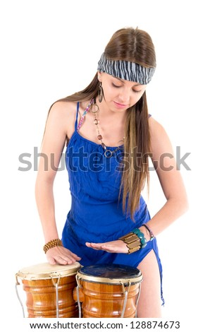 Pretty girl playing the drums - stock photo