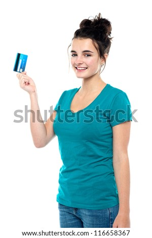 Pretty girl ready to make use of her cash card. Its shopping time! - stock photo