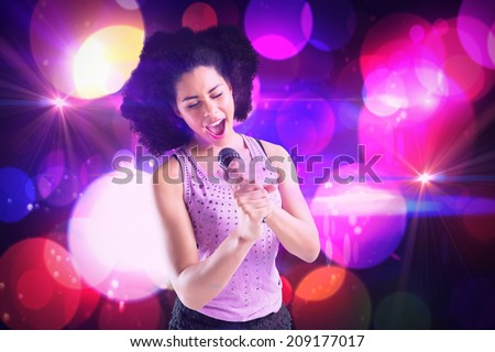 Pretty girl singing against digitally generated cool nightlife design - stock photo