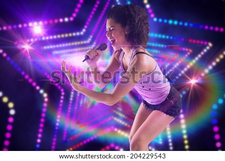 Pretty girl singing against digitally generated star laser background - stock photo