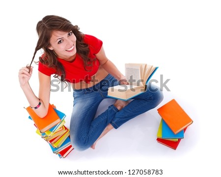 Pretty girl sitting in the floor and reading - stock photo