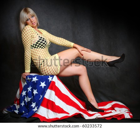 Pretty girl sitting on a american flag. Great for calendar - stock photo