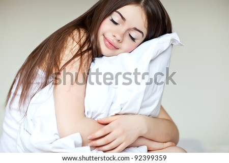 pretty  girl sitting on the bed at home waking up - stock photo