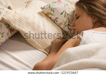 Pretty girl sleeping on the bed - stock photo